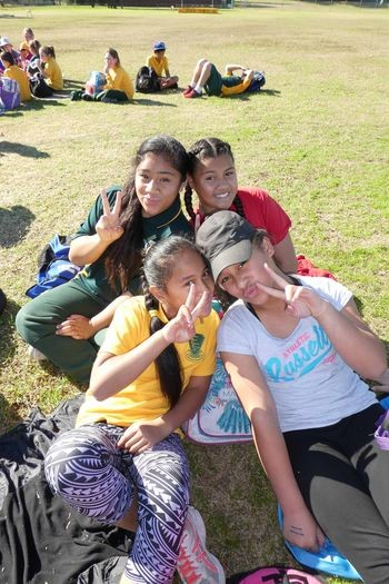 Students posed and smiling during the Primary Athletics carnival